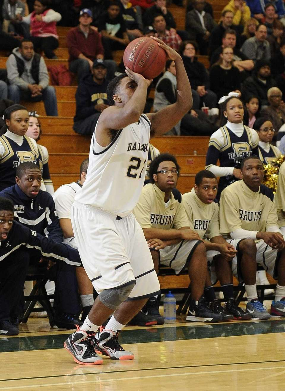 Baldwin's Mike Abrahams attempts a three-point shot against