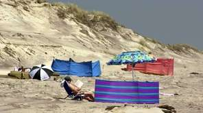 At a beach on Fire Island with nude,