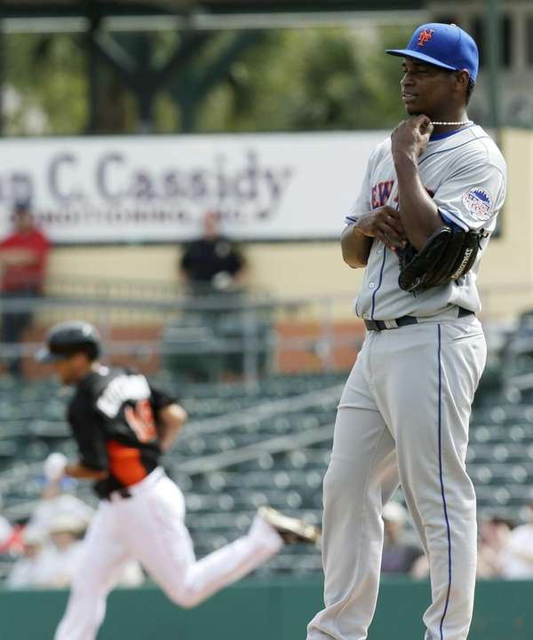 Mets relief pitcher Jenrry Mejia, right, stand on