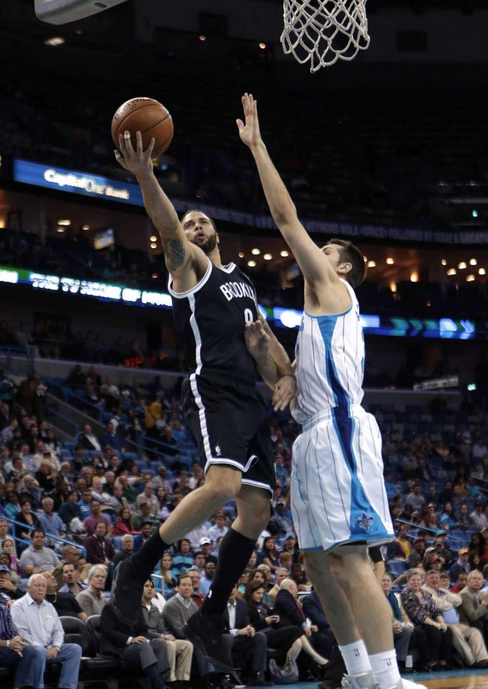 Nets guard Deron Williams drives to the basket