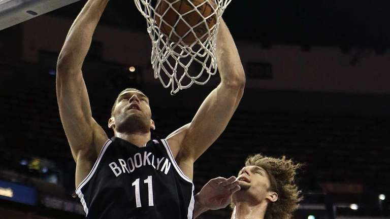 Nets center Brook Lopez slam dunks over his