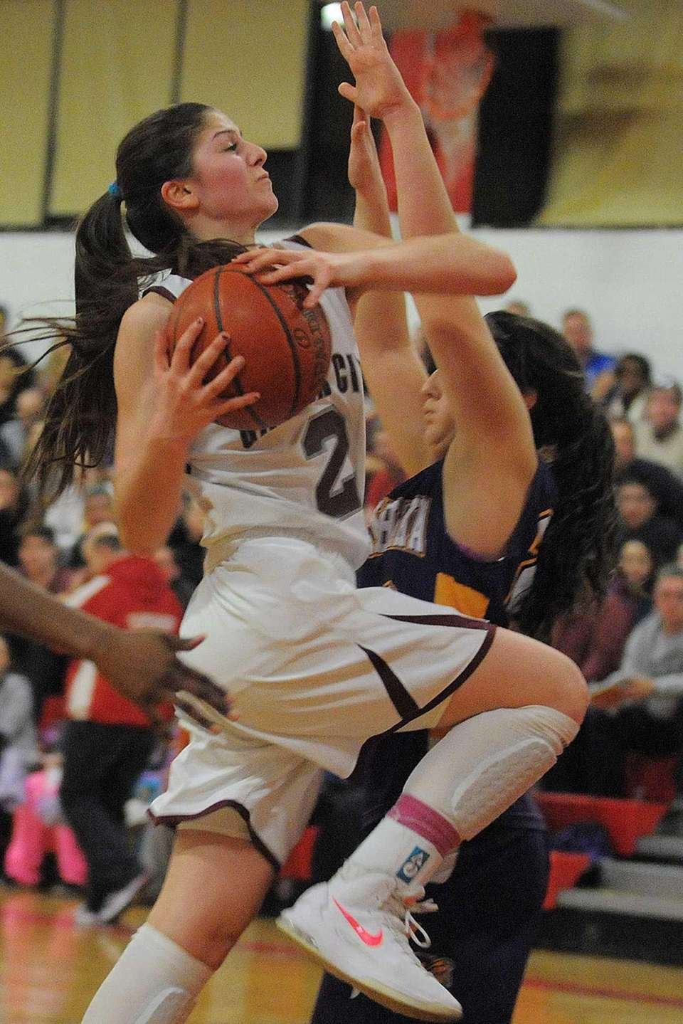Garden City's Samantha Auricchio draws a foul during