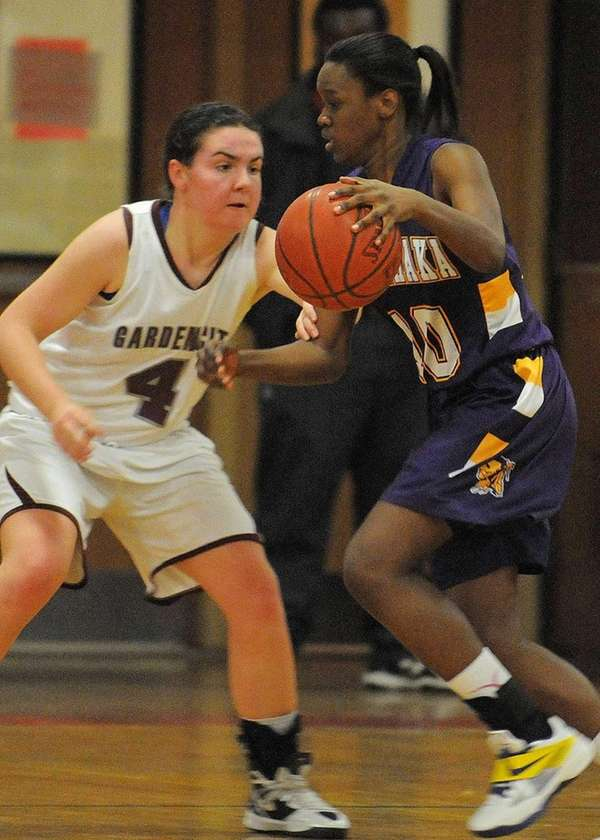 Sewanhaka's Shantell McCall, right, looks to drive past