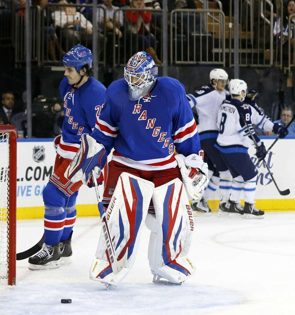 Henrik Lundqvist and Brian Boyle of the Rangers