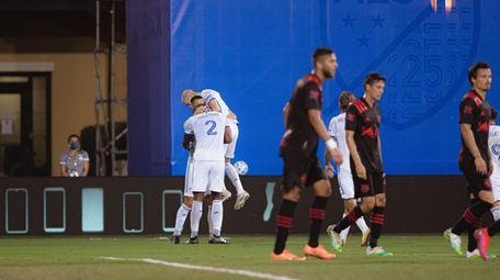 FC Cincinnati players celebrate a goal during a
