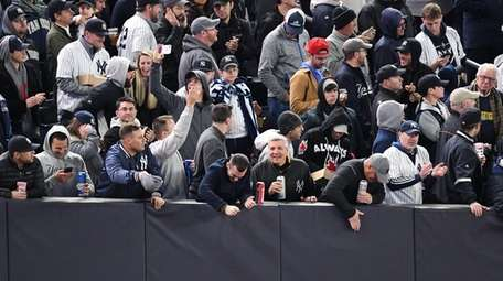Fans react in rightfield during the fifth inning