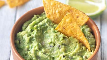Guacamole with tortilla chips.