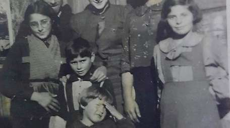 Gita Shorr (second from left, directly behind the