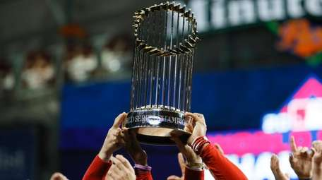 The championship trophy is held up after Game