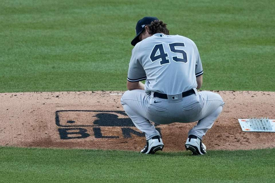 New York Yankees starting pitcher Gerrit Cole pauses