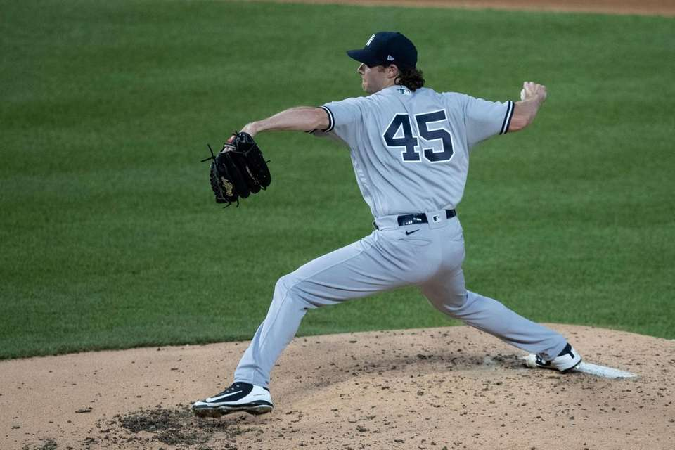 New York Yankees starting pitcher Gerrit Cole throws