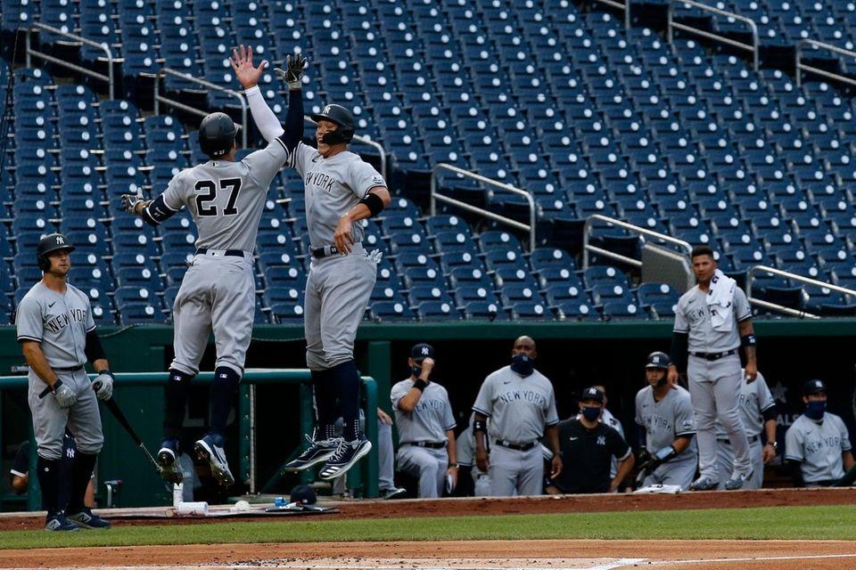 Yankees' Giancarlo Stanton (27) jumps to celebrate his
