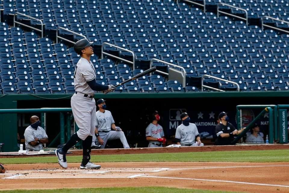 New York Yankees' Giancarlo Stanton watches his two-run
