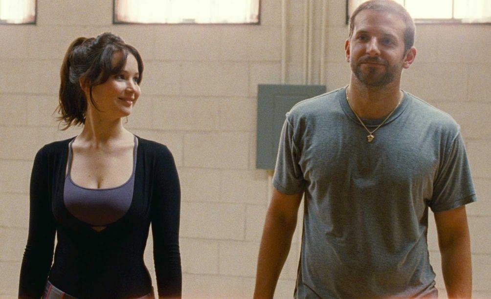 Jennifer Lawrence and Bradley Cooper, in a scene