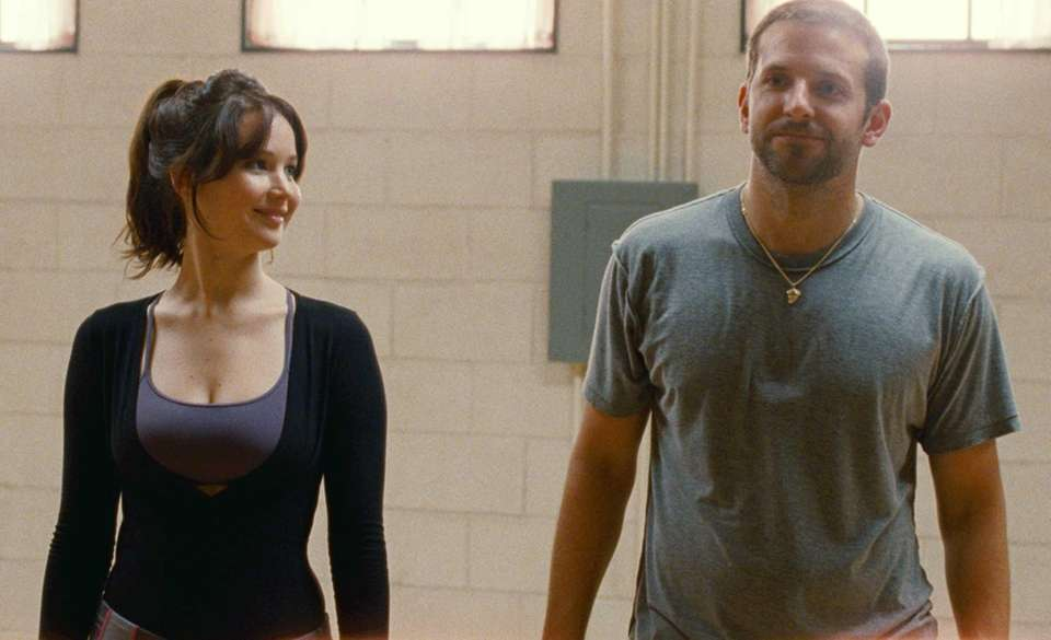 Jennifer Lawrence and Bradley Cooper, in a scene