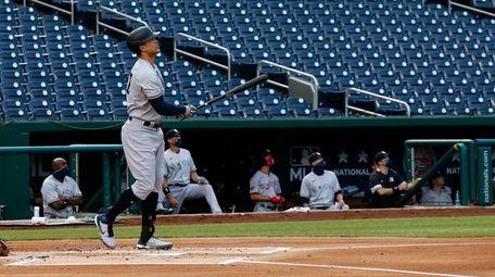 Yankees' Giancarlo Stanton watches his two-run home run