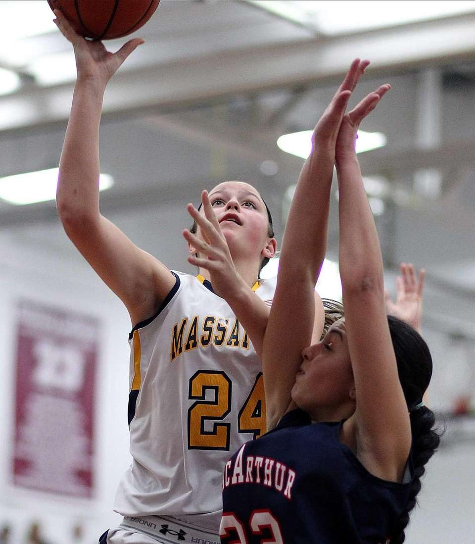 Massapequa's Melanie Hingher looks for a shot over
