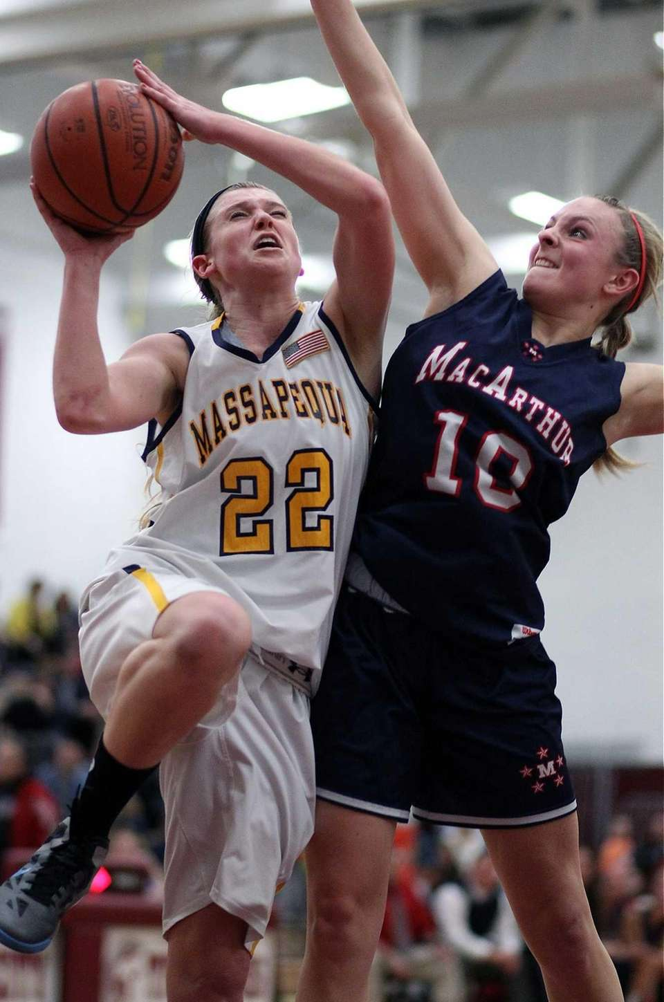 Massapequa's Lauren Van Buren shoots from under the