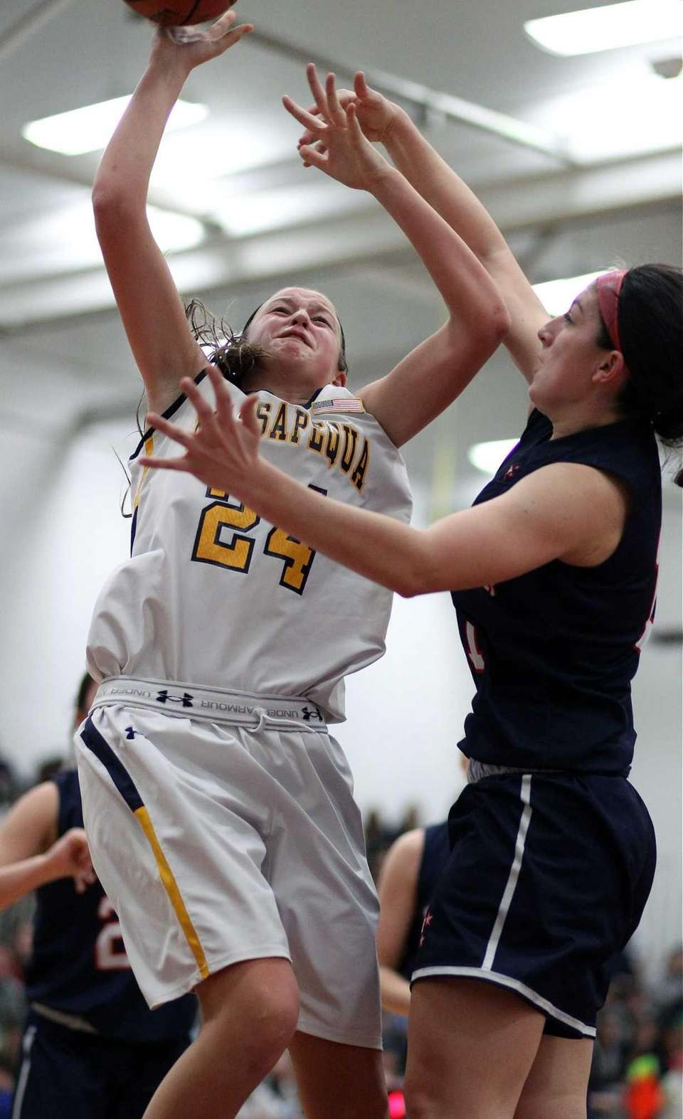 Massapequa's Melanie Hingher looks for inside shot against