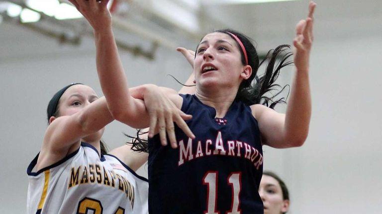 MacArthur's Jena Cozza shoots against Massapequa's Melanie Hingher.
