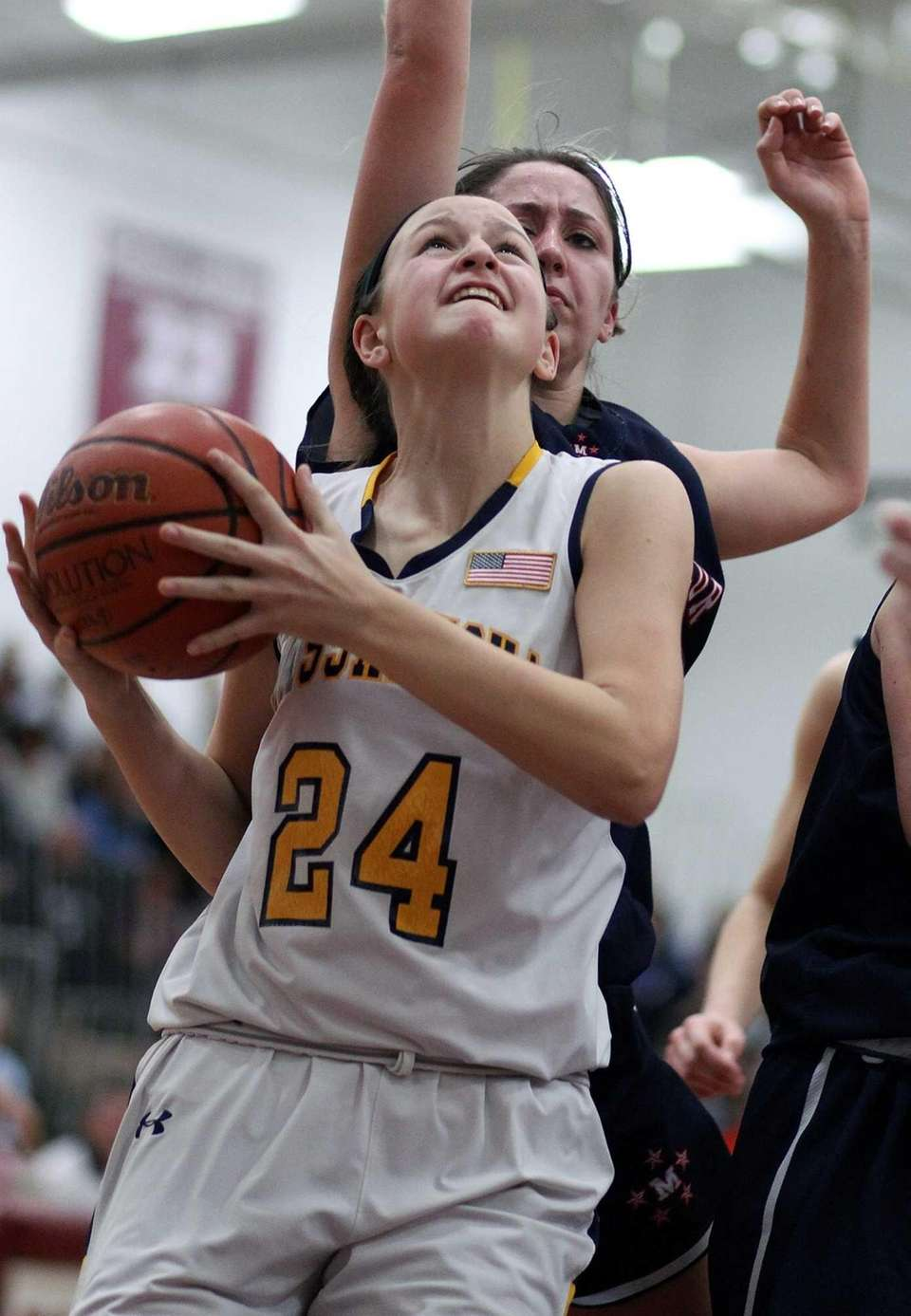 Massapequa's Melanie Hingher looks for a shot under