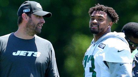 Jets head coach Adam Gase talks to safety