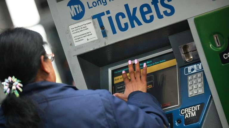 A Long Island Rail Road rider purchases a
