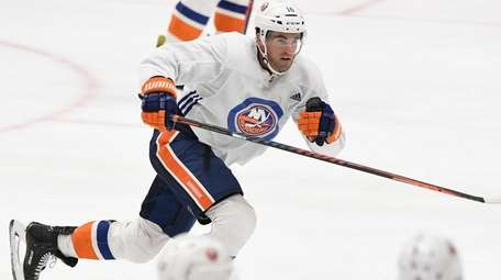 Islanders forward Andrew Ladd skates during an summer