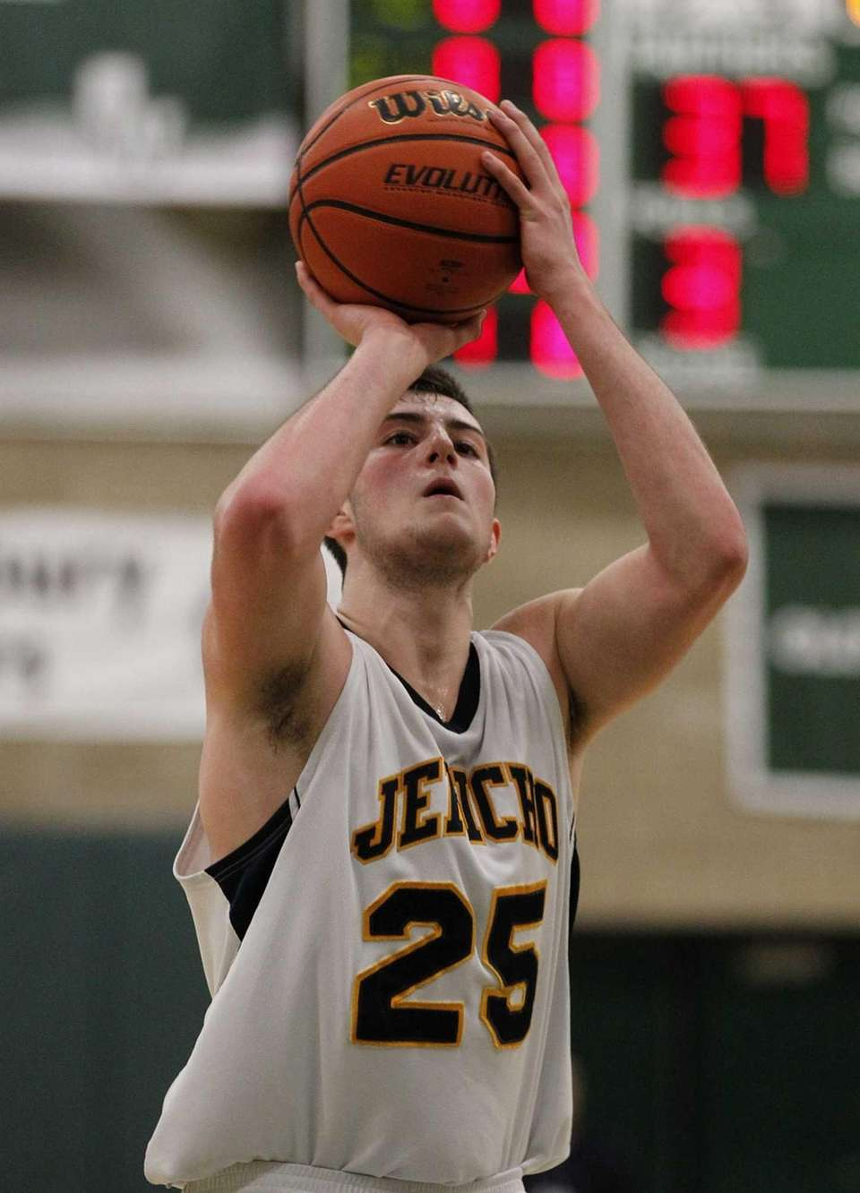 Garrett Johnson of Jericho attempts a three throw