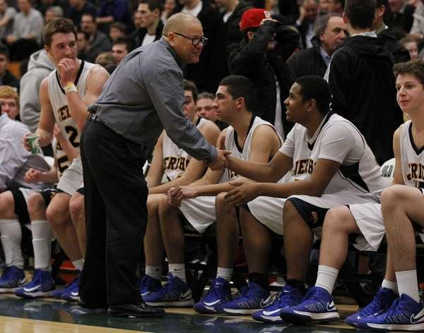 Jericho coach Wally Bachman celebrates with his team