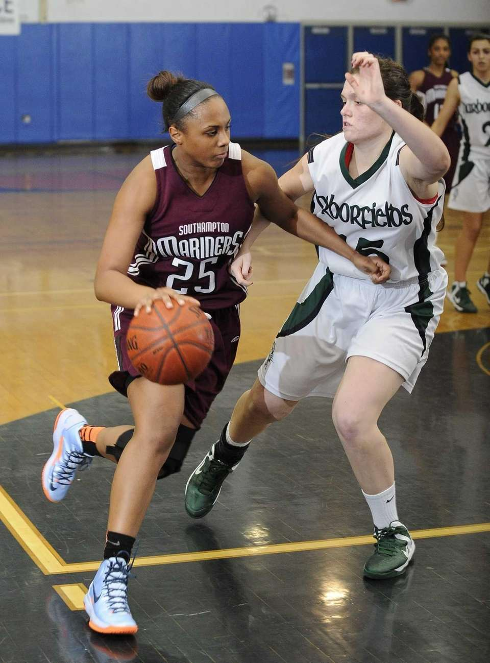 Southampton's Kesi Goree drives around Harborfields' Kristen Kelly
