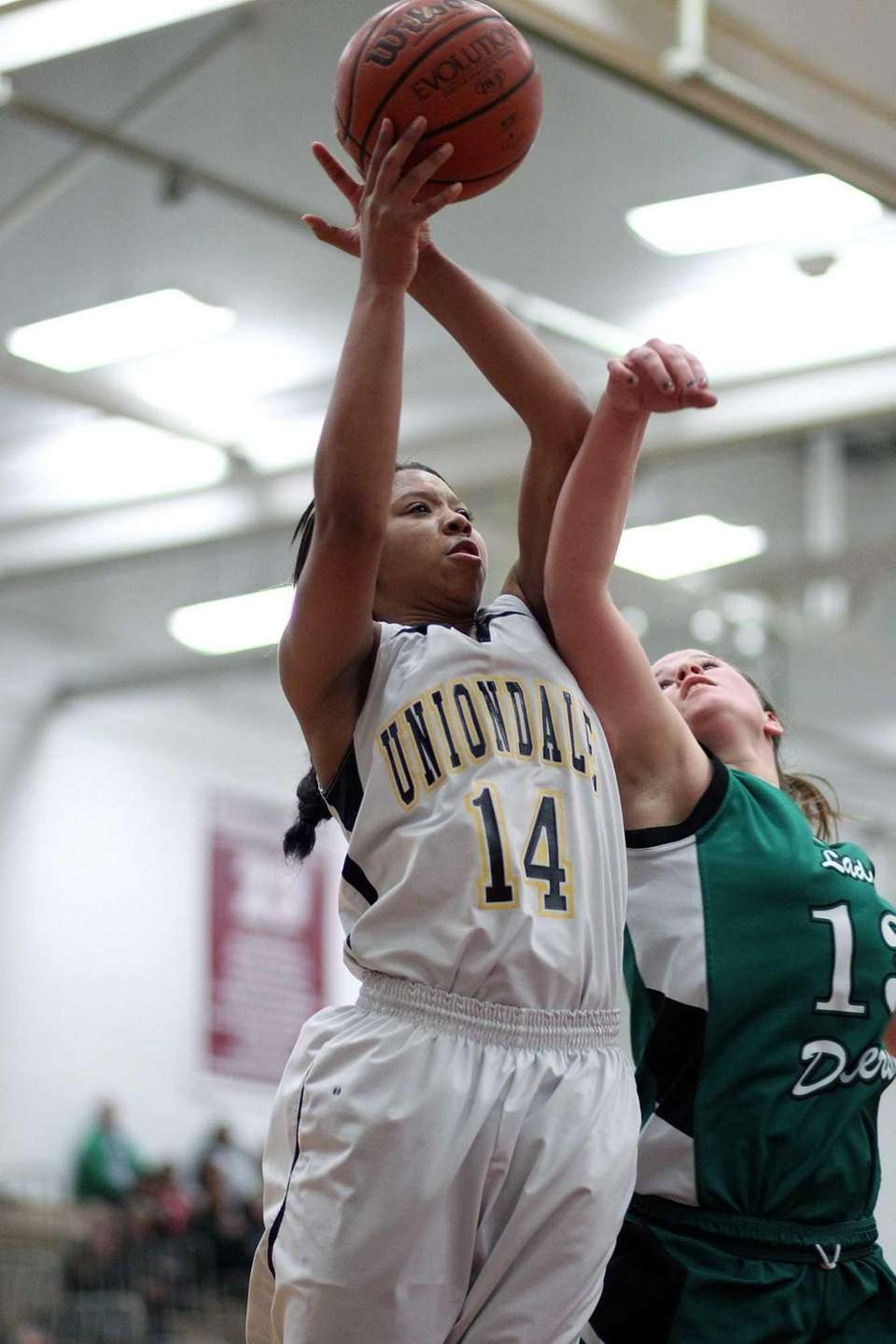 Uniondale's Jayda Hyatt goes for the ball against