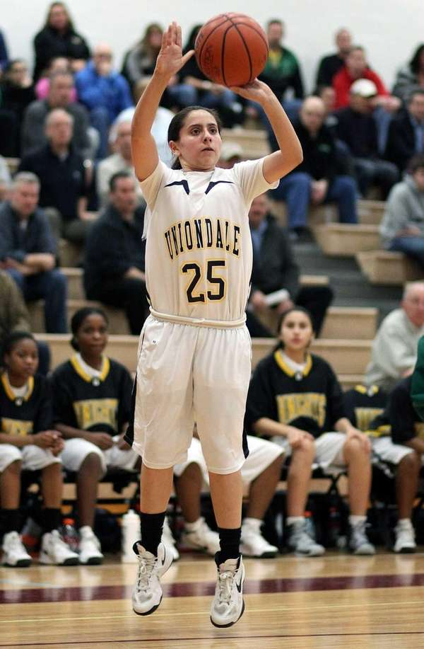 Uniondale's Ashley Jara shoots a three-pointer against Farmingdale.
