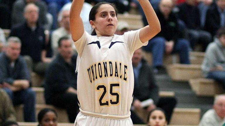 Uniondale's Ashley Jara shoots a three-pointer against Farmingdale.