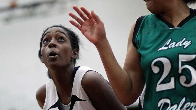 Uniondale's Alicia Lebby works against Farmingdale's Courtney Irby.