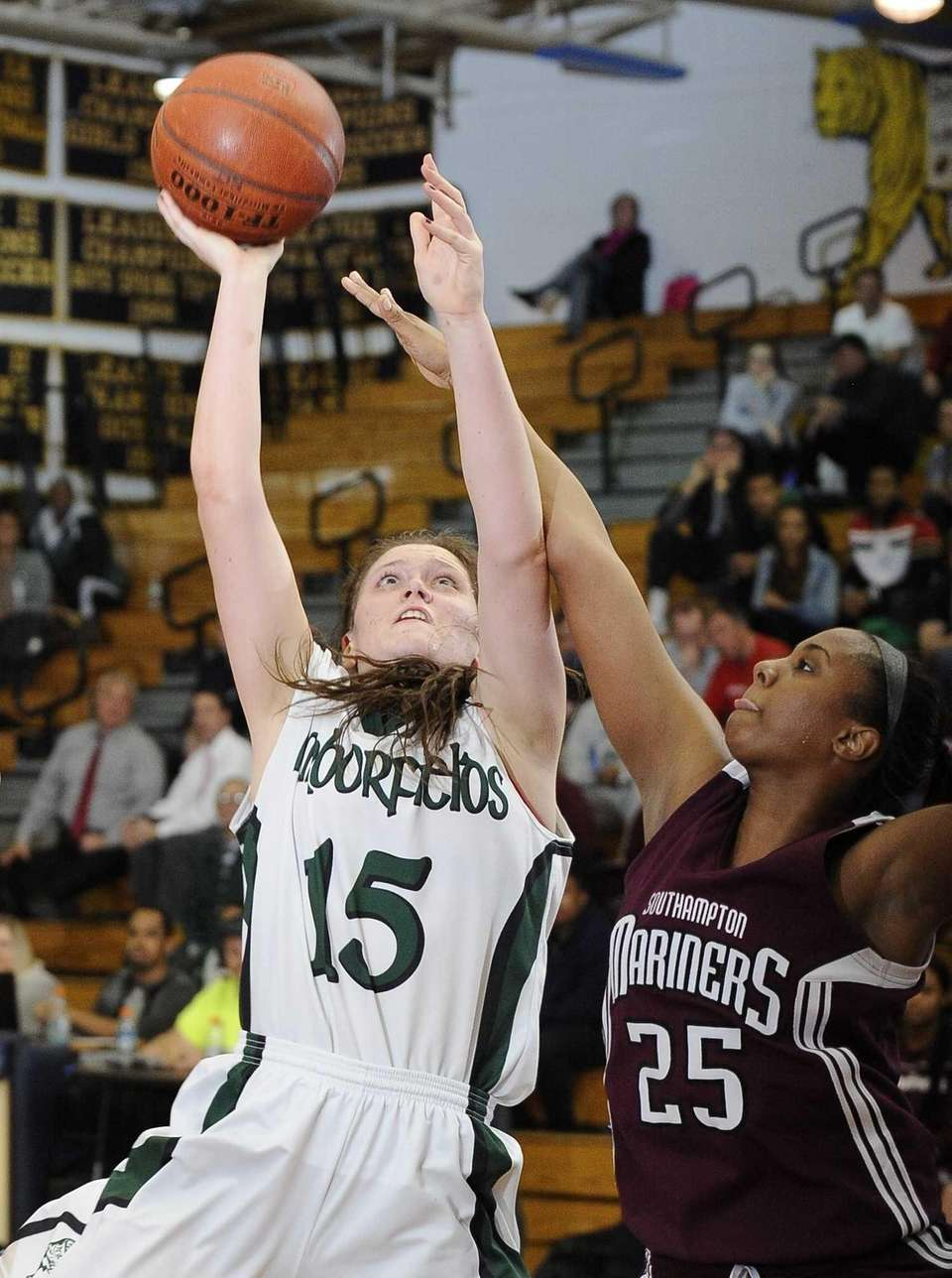 Harborfields' Kristen Kelly shoots as Southampton's Kesi Goree