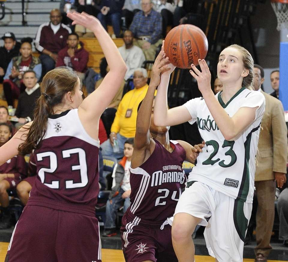 Harborfields' Toni Deren shoots defended by Southampton's Cassidy