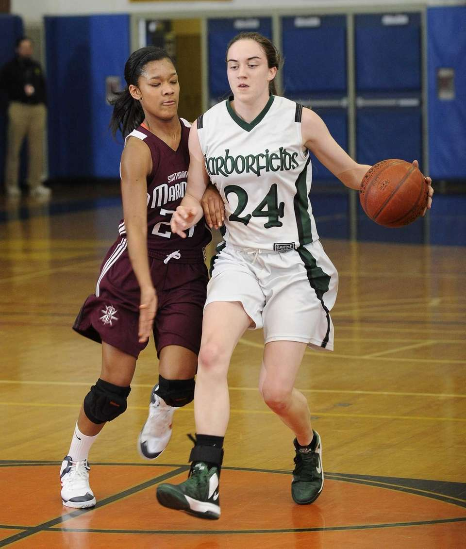 Harborfields' Bridgit Ryan is defended by Southampton's Paris