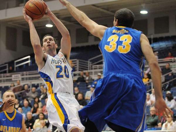 Hofstra's Matt Grogan, left, attempts to get a