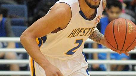 Hofstra's Taran Buie dribbles upcourt during the first