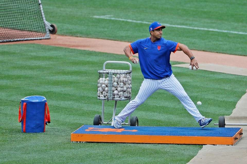 New York Mets manager Luis Rojas throws during