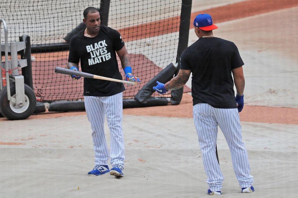 Yoenis Cespedes, left, wears a Black Lives Matter