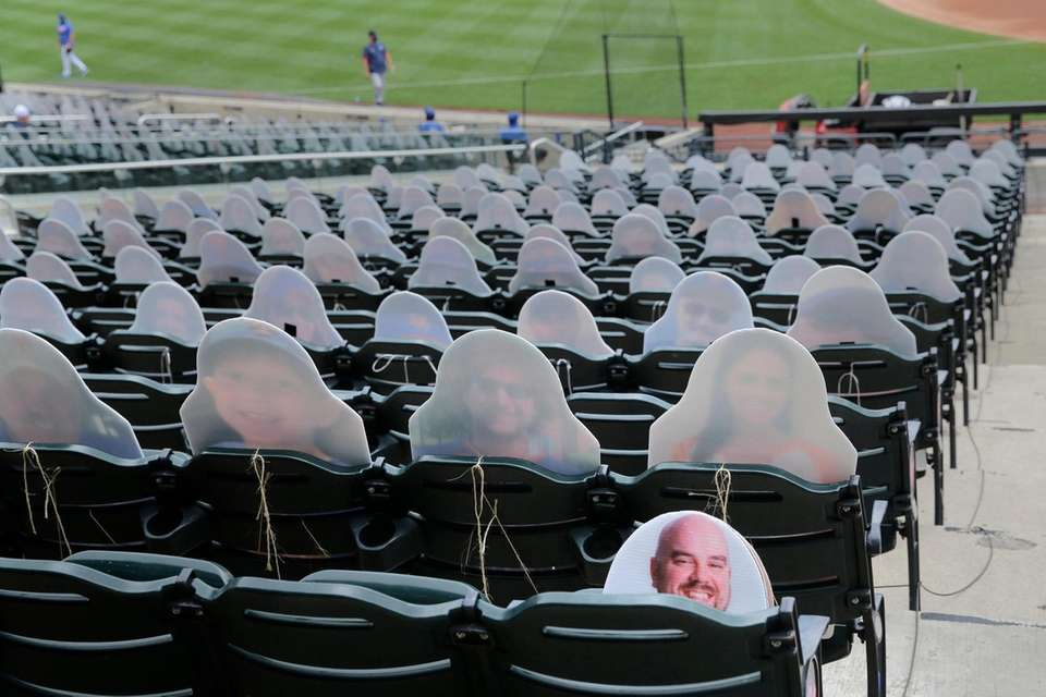 Cutouts of fans fill some of the seats