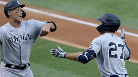 Giancarlo Stanton celebrates with Aaron Judge after hitting