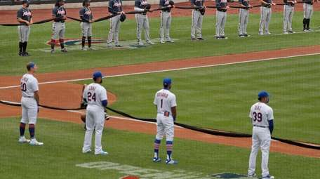 Mets and Braves players  hold a black