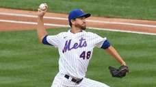 Mets starting pitcher Jacob deGrom delivers against the