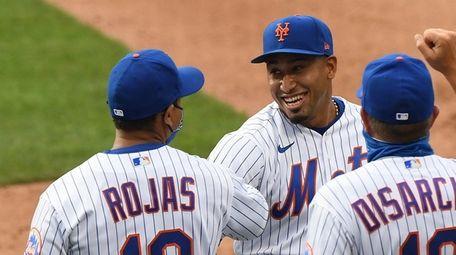 New York Mets relief pitcher Edwin Diaz, facing,