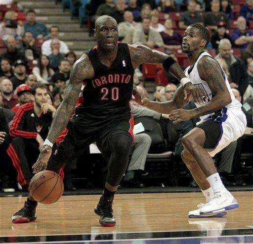 Toronto Raptors forward Mickael Pietrus, left, drives against