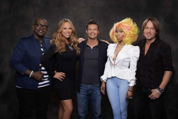"""American Idol? host Ryan Seacrest, center, is flanked"
