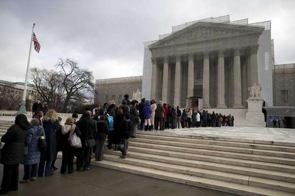 People wait in line outside the Supreme Court